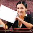 Businesswoman with a sheet of paper — Stock Photo