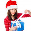 Girl in Santa hat with gifts — Stock Photo #8329178