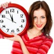 Woman with the clock isolated in white - Foto Stock