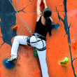 Girl climbing on a climbing wall — Stock Photo