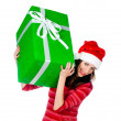 Stock Photo: Girl in Santa hat with gifts