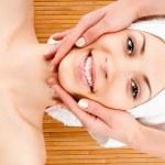 Woman receiving facial massage — Stock Photo