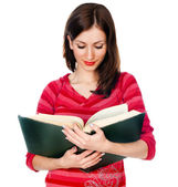 Beautiful girl student reading a book — Stock Photo