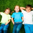 Kids on grass — Stock Photo