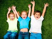 Kids on grass — Stock Photo
