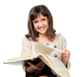 Little girl with a book — Stockfoto
