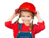 Beautiful little girl in the construction helmet — Stock Photo