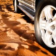Wheel of a car on the sand — Stock Photo