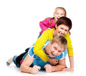 Young family is on a white floor — Stock Photo