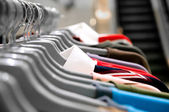 Garment hanging on hangers — Stock Photo