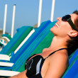 Beautiful girl lying on lounger — Stock Photo #9972137
