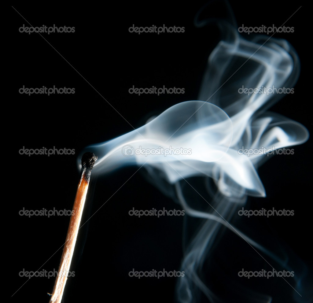 Extinguished the match with smoke on black background — Stock Photo #9972115
