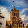 Dramatic English church against blue sky — Stock Photo #10465908