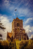 Dramatic English church against blue sky — Stock Photo