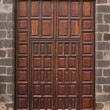 Imposing wooden doors entry - Stock Photo