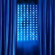 Stage spotlights blue curtains — Stock Photo #9324690