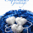 Royalty-Free Stock Photo: Silver Christmas hearts on blue