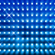 Sparkling blue spotlight wall - Stock Photo