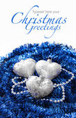 Silver Christmas hearts on blue — Stock Photo