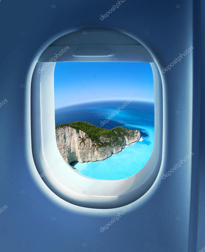 Approaching solitaire paradise island holiday destination, jet plane window sky view — Stock Photo #9324243