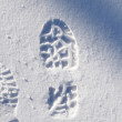 Human footprint in snow — Stock Photo