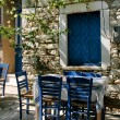 Greek outdoor tavern table — Stock Photo #9337793