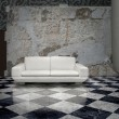Grunge wall white sofa - Stock Photo