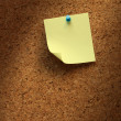 Royalty-Free Stock Photo: Yellow note paper on cork
