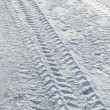 Vehicle tyre tracks on snow — Stock Photo