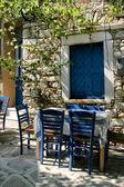Greek outdoor tavern table — Stock Photo