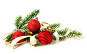 Red Christmas balls and green branch — Stock Photo