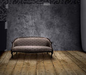 Sofa in mystery room — Stock Photo
