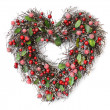Heart shaped Christmas garland on white background — Stock Photo