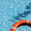 Stock Photo: Pool and life saver