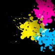 Cmyk color splatter - Stock Photo