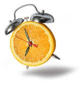 Orange alarm clock ringing — Stock Photo