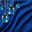 Christmas balls blue curtain — Stock Photo
