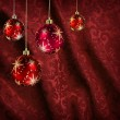 Red curtain christmas balls — Stock Photo
