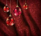 Red curtain christmas balls — Stockfoto