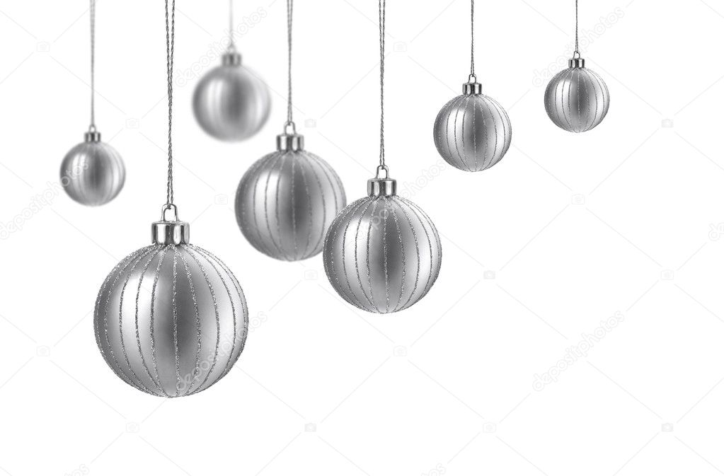 Silver matte christmas decoration balls hanging on white background  Stock Photo #9388701