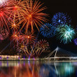 Colorful fireworks near water - Stock Photo