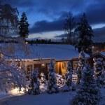 Snowy house on Christmas evening — Stock Photo #9399792