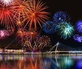 Colorful fireworks near water — Stock Photo
