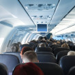 Passengers in airplane cabin interior — Stock Photo #9685270