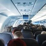 Passengers in airplane cabin interior — Stock Photo