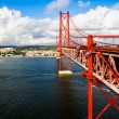 Red Suspension metallic Bridge in Lisbon — Stock Photo
