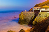 House on a cliff on sunset, Portugal. — Stock Photo