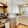 White kitchen with stainless steal appliances. — Stock Photo #10007369