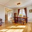 Dining room with brown curtain and hardwood floor. — Stock Photo