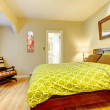 Modern green and beige bedroom with brown bed. — Stock Photo
